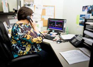 Crossfield Receptionist answering phone